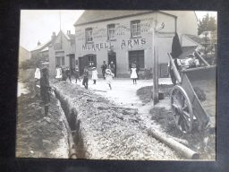 Children come out to play as the workmen have a break in the pub on Monday July 10th 1911.